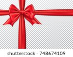 red gift bow and ribbon. | Shutterstock .eps vector #748674109