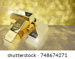 golds bar bokeh background   Shutterstock . vector #748674271