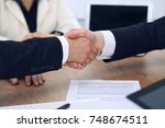 close up of business people... | Shutterstock . vector #748674511
