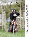 Beautiful steampunk model entering a gated pond - stock photo