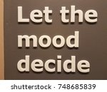 Small photo of let the mood decide sign