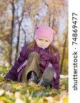 girl sitting in the yellow... | Shutterstock . vector #74869477