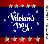 veterans day handwritten... | Shutterstock .eps vector #748695451