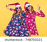 christmas new year. two young... | Shutterstock . vector #748703221
