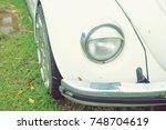 front headlight of an old car. | Shutterstock . vector #748704619