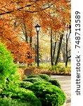 walking in autumn park next to... | Shutterstock . vector #748713589