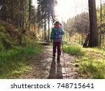 family hike in natural autumn... | Shutterstock . vector #748715641