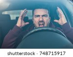 rude man driving his car and... | Shutterstock . vector #748715917