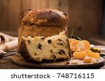 slice of a panettone close up.... | Shutterstock . vector #748716115