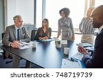 mature manager talking to a... | Shutterstock . vector #748719739