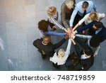 high angle view of a team of... | Shutterstock . vector #748719859