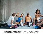 friends in sportswear high... | Shutterstock . vector #748721899