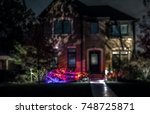 Seasonal Halloween House Lights Decoration at night, outdoor blurred defocused view - stock photo