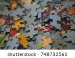 hand put the last piece of... | Shutterstock . vector #748732561