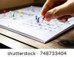 hands are pinning notes... | Shutterstock . vector #748733404