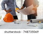 confident team of architect... | Shutterstock . vector #748735069