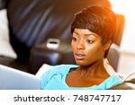 young beautiful woman working... | Shutterstock . vector #748747717