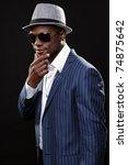 young black man wearing suit... | Shutterstock . vector #74875642