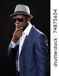 young black man wearing suit... | Shutterstock . vector #74875654