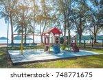 playground in beach garden on... | Shutterstock . vector #748771675