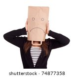 young woman in sad ecological paper bag on head, series - stock photo