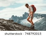 man hiking in mountains with... | Shutterstock . vector #748792015
