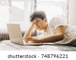 young boy student  studying... | Shutterstock . vector #748796221