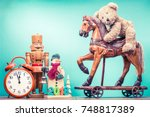 retro teddy bear toy riding... | Shutterstock . vector #748817389