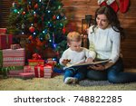 mother and son celebrate... | Shutterstock . vector #748822285