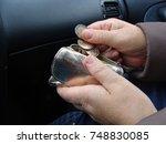 car passenger hands holding... | Shutterstock . vector #748830085