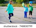 kids on a stadium | Shutterstock . vector #748830799