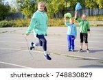 kids on a stadium | Shutterstock . vector #748830829