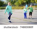 kids on a stadium | Shutterstock . vector #748830889
