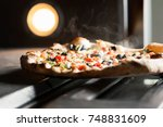 delicious pizza with a lot of... | Shutterstock . vector #748831609