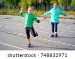 kids on a stadium | Shutterstock . vector #748832971