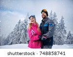 beautiful smiling couple... | Shutterstock . vector #748858741