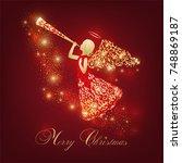 golden angel silhouette with... | Shutterstock .eps vector #748869187