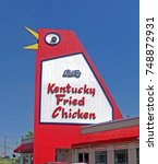 Small photo of Marietta GA - 30 Oct 2017: The Big Chicken KFC a well known local landmark at the intersection of Cobb Pkwy-Roswell Rd. A large 56 foot large steel-sided sign with moving beak and eyes. Built in 1963