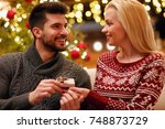 romantic man suprise woman with ... | Shutterstock . vector #748873729