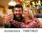 smiling romantic couple taking... | Shutterstock . vector #748873825
