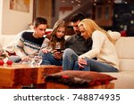 smiling family playing game on... | Shutterstock . vector #748874935