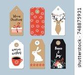 vintage christmas gift tags set....   Shutterstock .eps vector #748875931