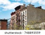block of historic buildings... | Shutterstock . vector #748893559