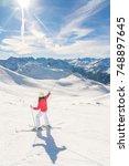 Young Woman Skier Enjoying A...