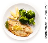 fried fish fillet with broccoli ... | Shutterstock . vector #748901797