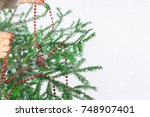 girl hanging new year red beads ... | Shutterstock . vector #748907401