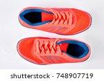 modern sport trainers  top view.... | Shutterstock . vector #748907719