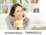 happy woman posing looking art... | Shutterstock . vector #748909231