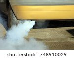 Small photo of Car Exhaust Smoke Emitting High Levels Of Harmful Gases Into The Environment Causing Air Pollution
