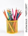 colored pencils in metal holder.... | Shutterstock . vector #748912897